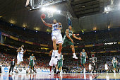 Sean May of the North Carolina Tar Heels leaps around Shannon Brown of the Michigan State Spartans for a basket in the second half during the NCAA...