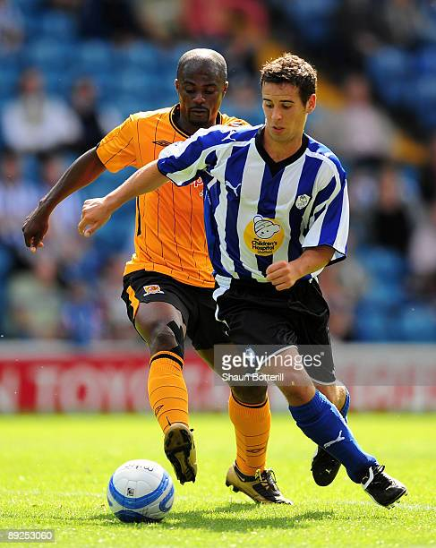 Sean McAllister of Sheffield wednesday is challenged by George Boateng of Hull City during the preseason friendly match between Sheffield Wednesday...