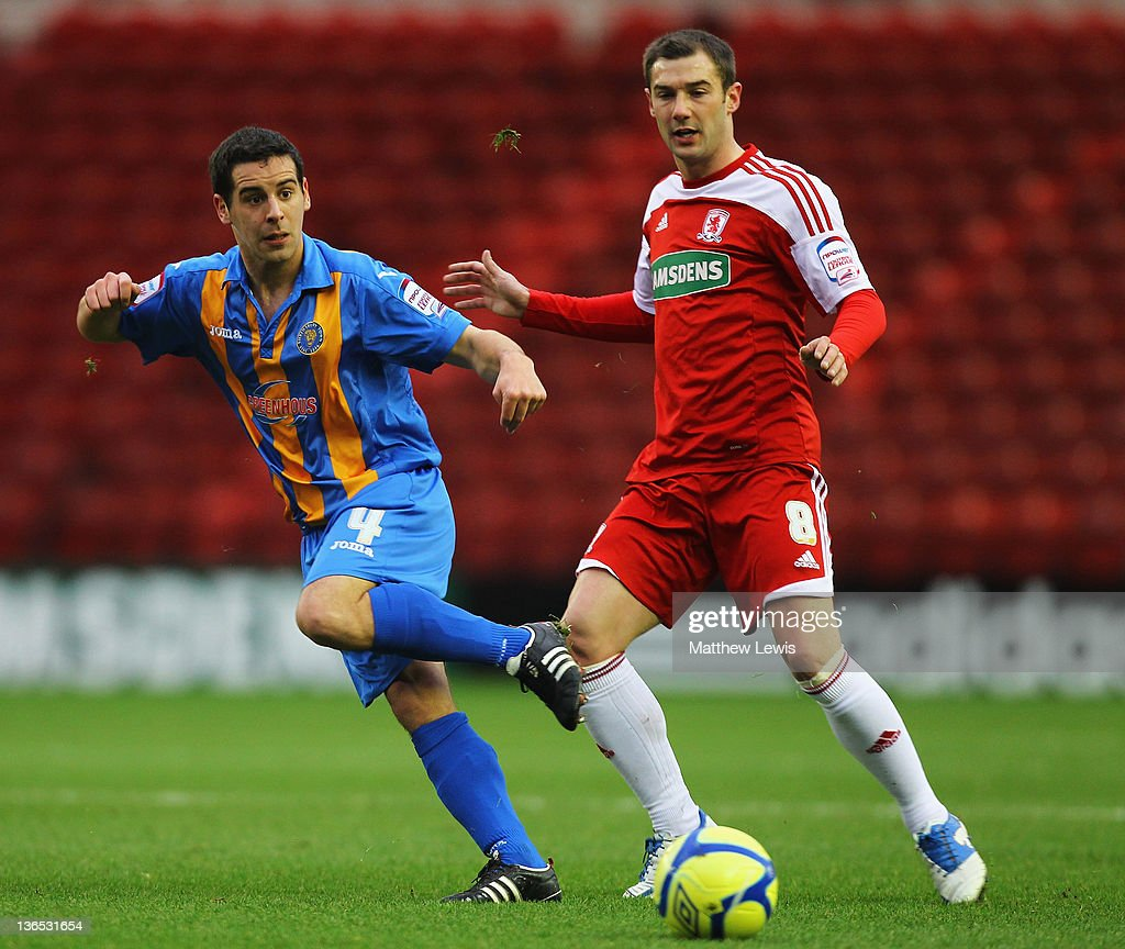Sean McAllister of Shrewsbyury and Kevin Thomson of Middlesbrough challenge for the ball during the FA Cup Third Round match between Middlesbrough and Shrewsbury Town at Riverside Stadium on January 7, 2012 in Middlesbrough, England.