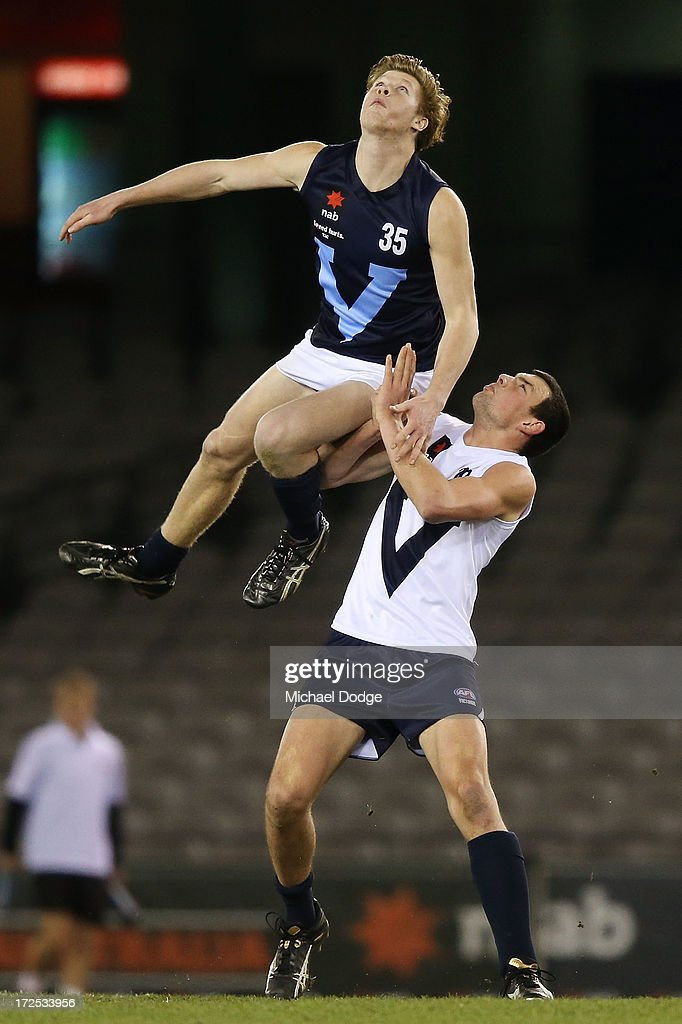 Sean McLaren of Vic Metro (L) and Kyle Hendy Vic Country contest for the ball during the AFL Under 18s Championship match between Victoria Country and Victoria Metro at Etihad Stadium on July 3, 2013 in Melbourne, Australia.