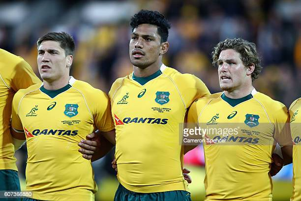 Sean McMahon Lopeti Timani and Michael Hooper of the Wallabies sing the Australian national anthem during the Rugby Championship match between the...
