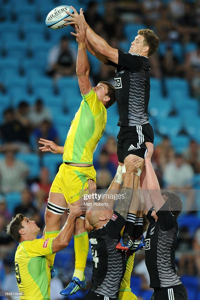 Sean McMahon of Australia and Scott Curry of New Zealand compete in the line out during the Gold Coast Sevens Cup final between Australia and New Zealand at Skilled Stadium on October 13, 2013 on the Gold Coast, Australia.
