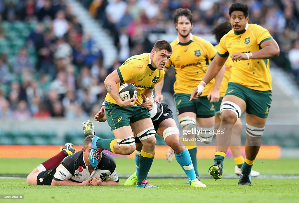 <a gi-track='captionPersonalityLinkClicked' href=/galleries/search?phrase=Sean+McMahon+-+Rugby+Player&family=editorial&specificpeople=13709100 ng-click='$event.stopPropagation()'>Sean McMahon</a> of Australia charges upfield during the Killick Cup match between the Barbarians and Australian Wallabies at Twickenham Stadium on November 1, 2014 in London, England.
