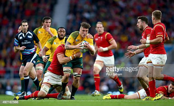 Sean McMahon of Australia is tackled by Luke Charteris of Wales during the 2015 Rugby World Cup Pool A match between Australia and Wales at...