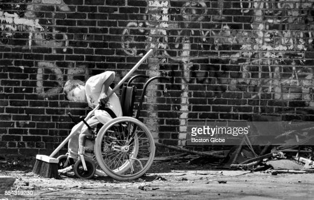 Sean McMahon of Randolph cleans up a vacant lot off Dudley Street in the Roxbury neighborhood of Boston as more than 3500 volunteers from HOPE Boston...