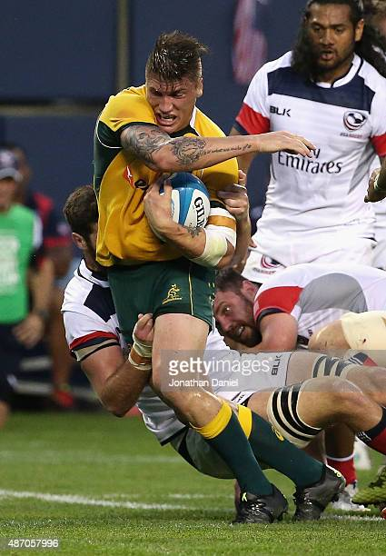 Sean McMahon of the Australia Wallabies is tackled against the United States Eagles during a match at Soldier Field on September 5 2015 in Chicago...