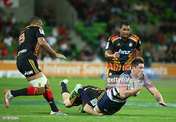 Sean McMahon of the Rebels is challenged by Brad Weber of the Chiefs during the round 12 Super Rugby match between the Rebels and the Chiefs at AAMI...