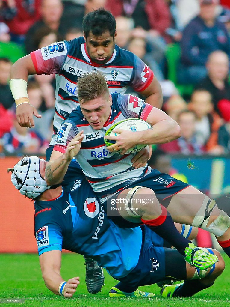 <a gi-track='captionPersonalityLinkClicked' href=/galleries/search?phrase=Sean+McMahon+-+Rugby+Player&family=editorial&specificpeople=13709100 ng-click='$event.stopPropagation()'>Sean McMahon</a> of the Rebels is tackled during the round 17 Super Rugby match between the Rebels and the Bulls at AAMI Park on June 6, 2015 in Melbourne, Australia.