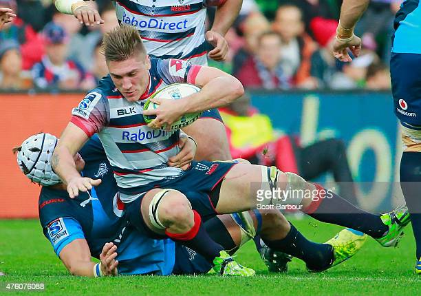 Sean McMahon of the Rebels is tackled during the round 17 Super Rugby match between the Rebels and the Bulls at AAMI Park on June 6 2015 in Melbourne...