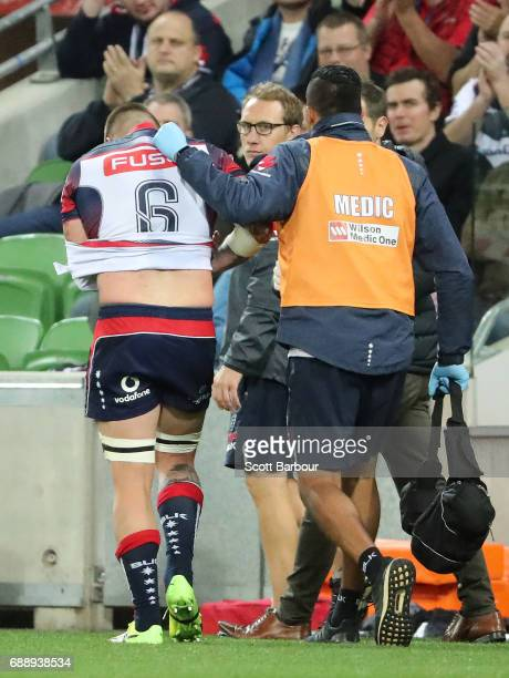 Sean McMahon of the Rebels leaves the field injured during the round 14 Super Rugby match between the Rebels and the Crusaders at AAMI Park on May 27...