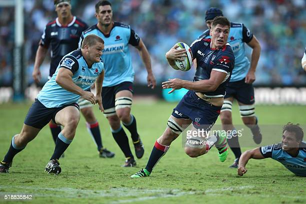 Sean McMahon of the Rebels makes a break during the round six Super Rugby match between the New South Wales Waratahs and the Melbourne Rebels at...