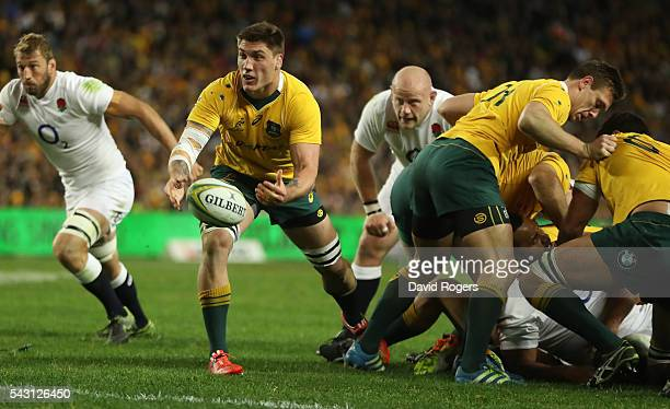 Sean McMahon of the Wallabies passes the ball during the International Test match between the Australian Wallabies and England at Allianz Stadium on...