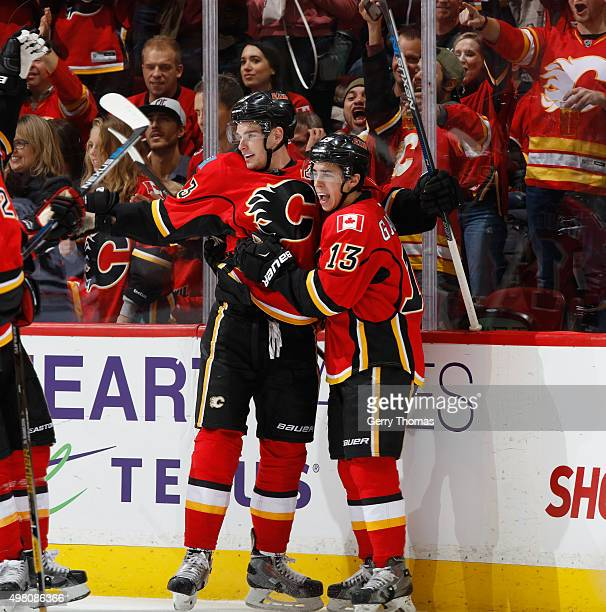 Sean Monahan and Johnny Gaudreau of the Calgary Flames celebrate after a goal against the Chicago Blackhawks at Scotiabank Saddledome on November 20...