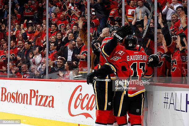 Sean Monahan and Johnny Gaudreau of the Calgary Flames celebrate a goal against the Buffalo Sabres during an NHL game at Scotiabank Saddledome on...
