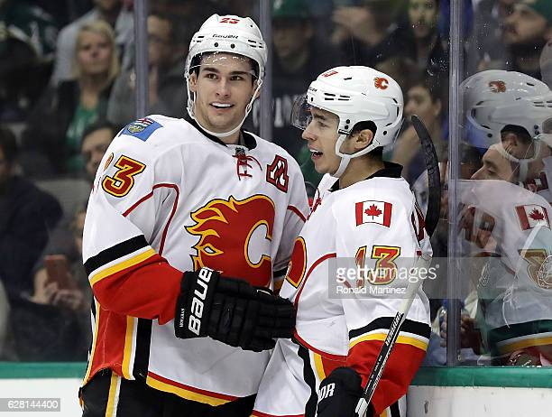 Sean Monahan and Johnny Gaudreau of the Calgary Flames celebrate a goal against the Dallas Stars in the second period at American Airlines Center on...