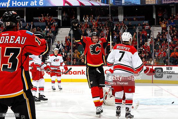 Sean Monahan and Johnny Gaudreau of the Calgary Flames celebrates a goal against the Carolina Hurricanes during an NHL game at Scotiabank Saddledome...