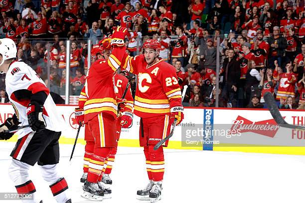 Sean Monahan and teammates of the Calgary Flames celebrate a goal against the Ottawa Senators during an NHL game at Scotiabank Saddledome on February...