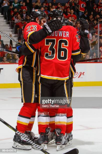 Sean Monahan and Troy Brouwer of the Calgary Flames celebrate after scoring in an NHL game against the Minnesota Wild at the Scotiabank Saddledome on...