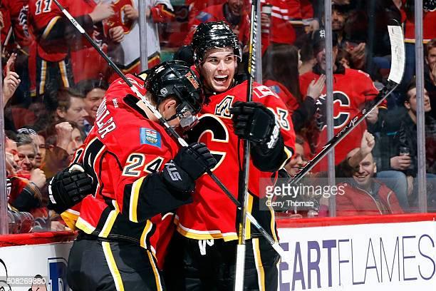 Sean Monahan Jiri Hudler and teammates of the Calgary Flames celebrate a goal against the Carolina Hurricanes during an NHL game at Scotiabank...