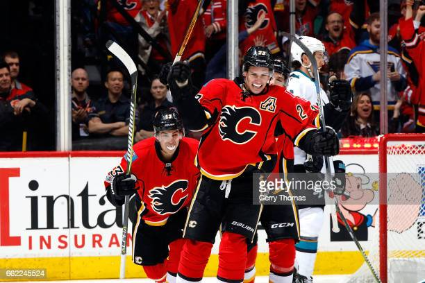 Sean Monahan Johnny Gaudreau and teammates of the Calgary Flames celebrate a goal against the San Jose Sharks during an NHL game on March 31 2017 at...