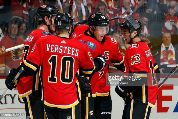 Sean Monahan Kris Versteeg Micheal Ferland and Johnny Gaudreau of the Calgary Flames celebrate after scoring against the Winnipeg Jets during an NHL...