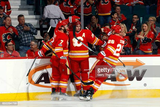 Sean Monahan Michael Stone and teammates of the Calgary Flames celebrate a goal against the Los Angeles Kings during an NHL game on March 19 2017 at...