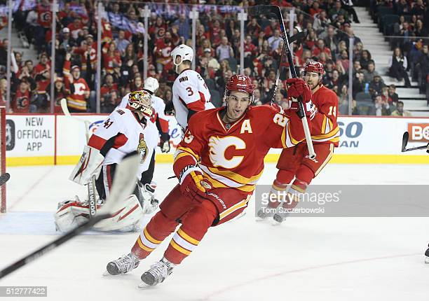 Sean Monahan of the Calgary Flames celebrates a goal scored by Johnny Gaudreau during their NHL game against the Ottawa Senators at the Scotiabank...