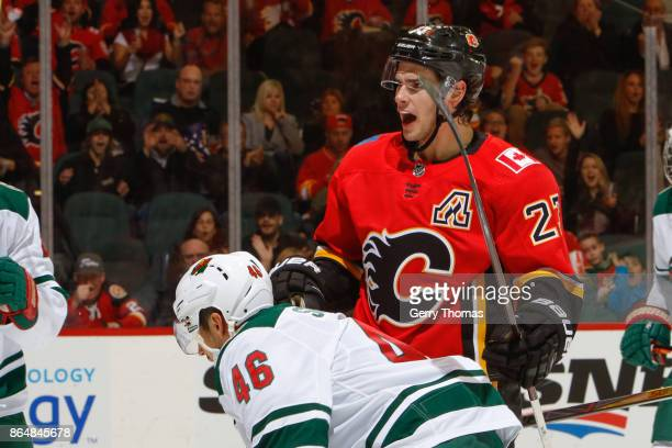 Sean Monahan of the Calgary Flames celebrates after scoring a goal in an NHL game against the Minnesota Wild at the Scotiabank Saddledome on October...
