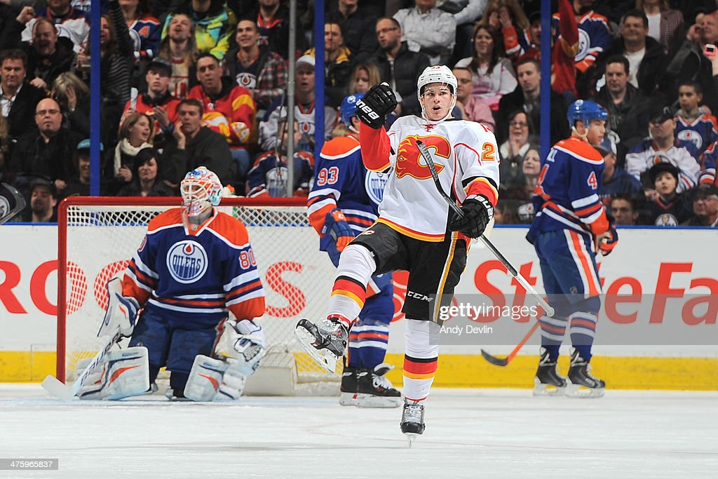 Sean Monahan #23 of the Calgary Flames celebrates after scoring a goal against the Edmonton Oilers on March 1, 2014 at Rexall Place in Edmonton, Alberta, Canada.