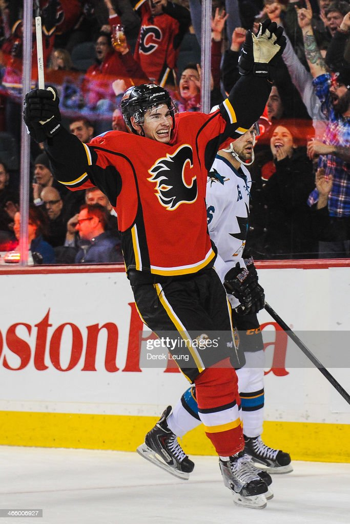 Sean Monahan #23 of the Calgary Flames celebrates after scoring against Alex Stalock #32 (not pictured) of the San Jose Sharks during an NHL game at Scotiabank Saddledome on January 30, 2014 in Calgary, Alberta, Canada. The Flames defeated the Sharks 4-1.