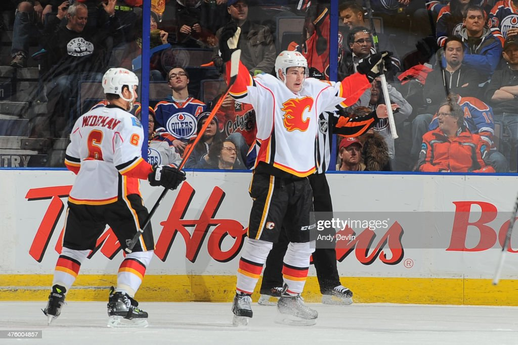 Sean Monahan #23 of the Calgary Flames celebrates after scoring the game winning the goal in a game against the Edmonton Oilers on March 1, 2014 at Rexall Place in Edmonton, Alberta, Canada.