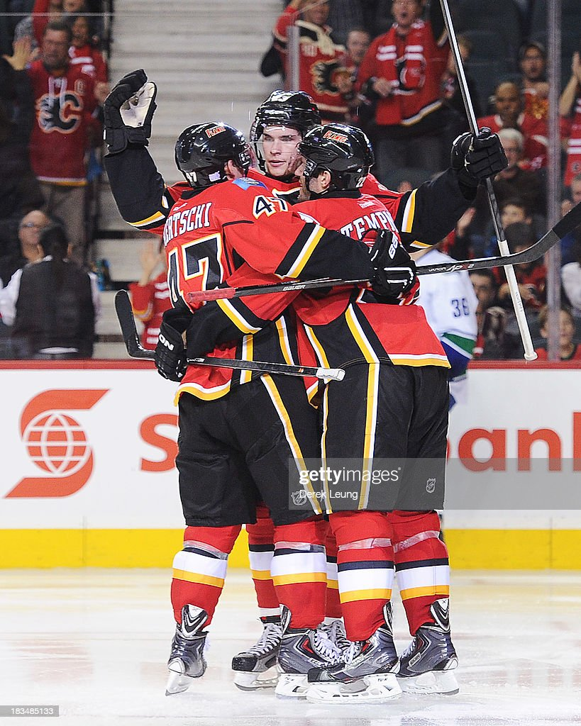 Sean Monahan #23 of the Calgary Flames celebrates his goal against the Vancouver Canucks during the Flames' home opening NHL game at Scotiabank Saddledome on October 6, 2013 in Calgary, Alberta, Canada. The Vancouver Canucks won 5-4 in OT.