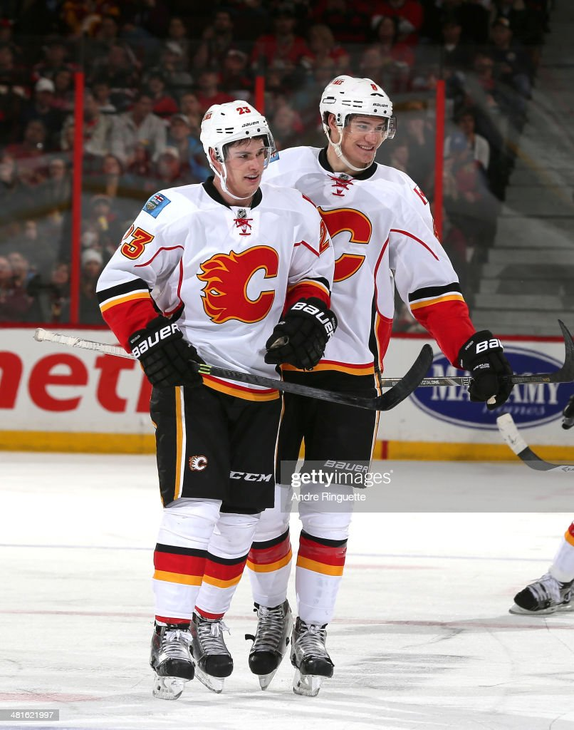 Sean Monahan #23 of the Calgary Flames celebrates his second period goal against the Ottawa Senators with teammate Joe Colborne #8 at Canadian Tire Centre on March 30, 2014 in Ottawa, Ontario, Canada.