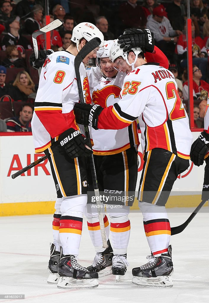 Sean Monahan #23 of the Calgary Flames celebrates his second period goal against the Ottawa Senators with teammates Joe Colborne #8 and Jiri Hudler #24 at Canadian Tire Centre on March 30, 2014 in Ottawa, Ontario, Canada.