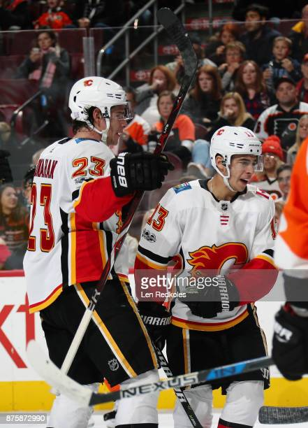 Sean Monahan of the Calgary Flames celebrates his third powerplay goal of the second period against the Philadelphia Flyers with Johnny Gaudreau on...