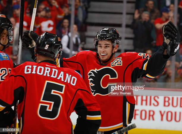 Sean Monahan of the Calgary Flames celebrates with teammates after a goal against the Anaheim Ducks at Scotiabank Saddledome on February 15 2016 in...