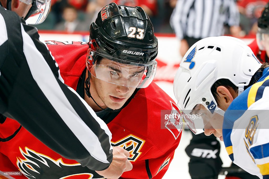 Sean Monahan #23 of the Calgary Flames faces off against Jori Lehtera #12 of the St. Louis Blues during an NHL game at Scotiabank Saddledome on October 13, 2015 in Calgary, Alberta, Canada.