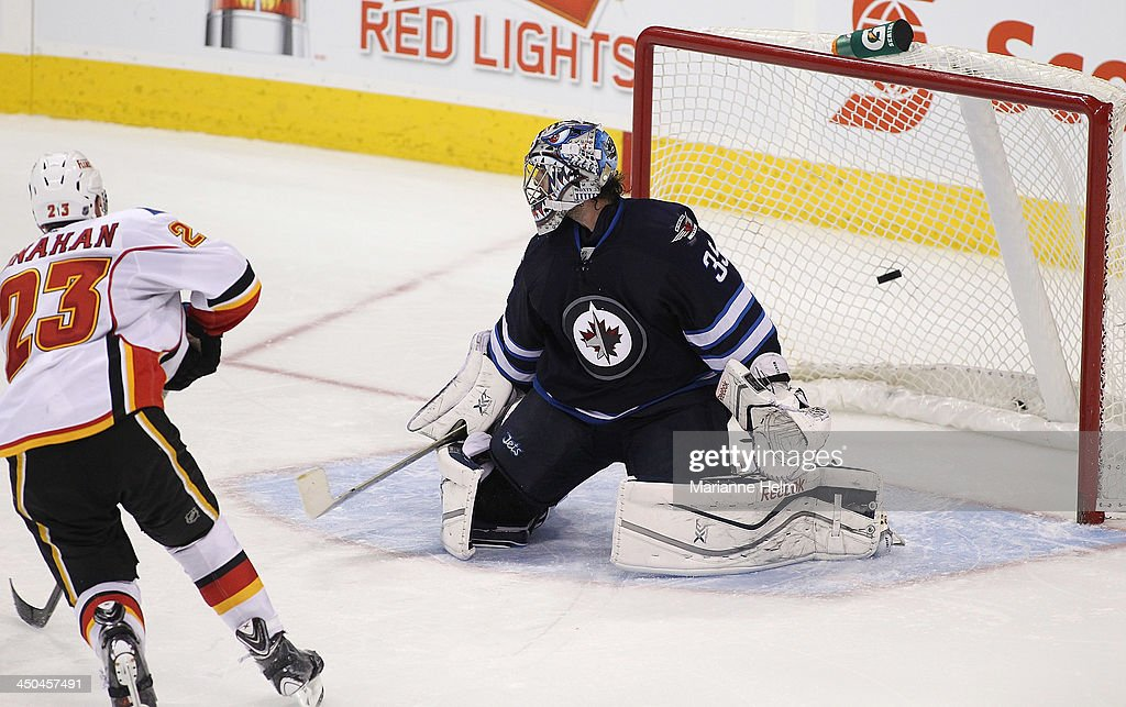 Sean Monahan #23 of the Calgary Flames gets the game-winning goal against Al Montoya #35 of the Winnipeg Jets in shootout action in an NHL game at the MTS Centre on November 18, 2013 in Winnipeg, Manitoba, Canada.