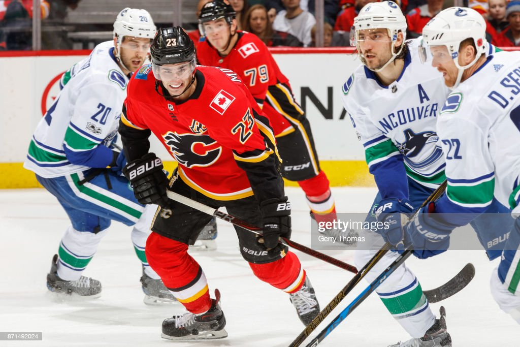 Sean Monahan #23 of the Calgary Flames goes after the puck in an NHL game against the Vancouver Canucks at the Scotiabank Saddledome on November 7, 2017 in Calgary, Alberta, Canada.