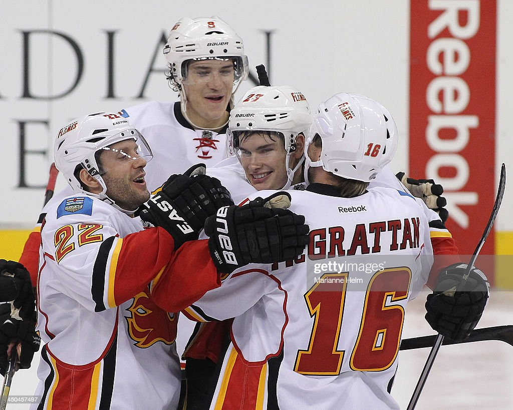 Sean Monahan #23 of the Calgary Flames is congratulated by teammates for his game-winning goal in shootout action in an NHL game against the Winnipeg Jets at the MTS Centre on November 18, 2013 in Winnipeg, Manitoba, Canada.