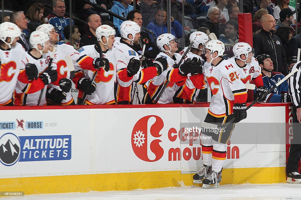Sean Monahan #23 of the Calgary Flames is congratulated by teammates after scoring against the Colorado Avalanche at the Pepsi Center on January 06, 2014 in Denver, Colorado.