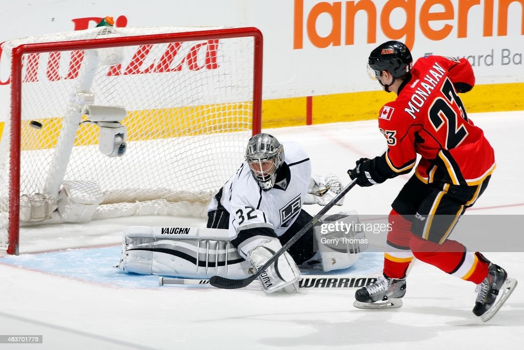 Sean Monahan #23 of the Calgary Flames scores the game winning shootout goal against <a gi-track='captionPersonalityLinkClicked' href=/galleries/search?phrase=Jonathan+Quick&family=editorial&specificpeople=2271852 ng-click='$event.stopPropagation()'>Jonathan Quick</a> #32 of the Los Angeles Kings at Scotiabank Saddledome on April 9, 2014 in Calgary, Alberta, Canada.