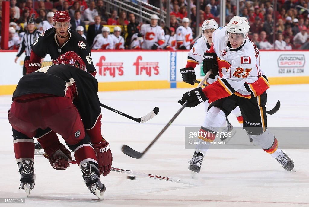 Sean Monahan #23 of the Calgary Flames shoots the puck against the Phoenix Coyotes during the third period of the NHL game at Jobing.com Arena on October 22, 2013 in Glendale, Arizona. The Coyotes defeated the Flames 4-2.