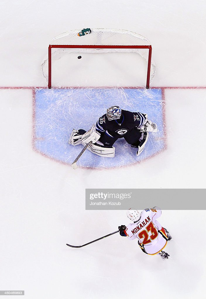 Sean Monahan #23 of the Calgary Flames shoots the puck over the shoulder of goaltender <a gi-track='captionPersonalityLinkClicked' href=/galleries/search?phrase=Al+Montoya&family=editorial&specificpeople=213916 ng-click='$event.stopPropagation()'>Al Montoya</a> #35 of the Winnipeg Jets during the shootout at the MTS Centre on November 18, 2013 in Winnipeg, Manitoba, Canada. The Flames defeated the Jets 5-4.