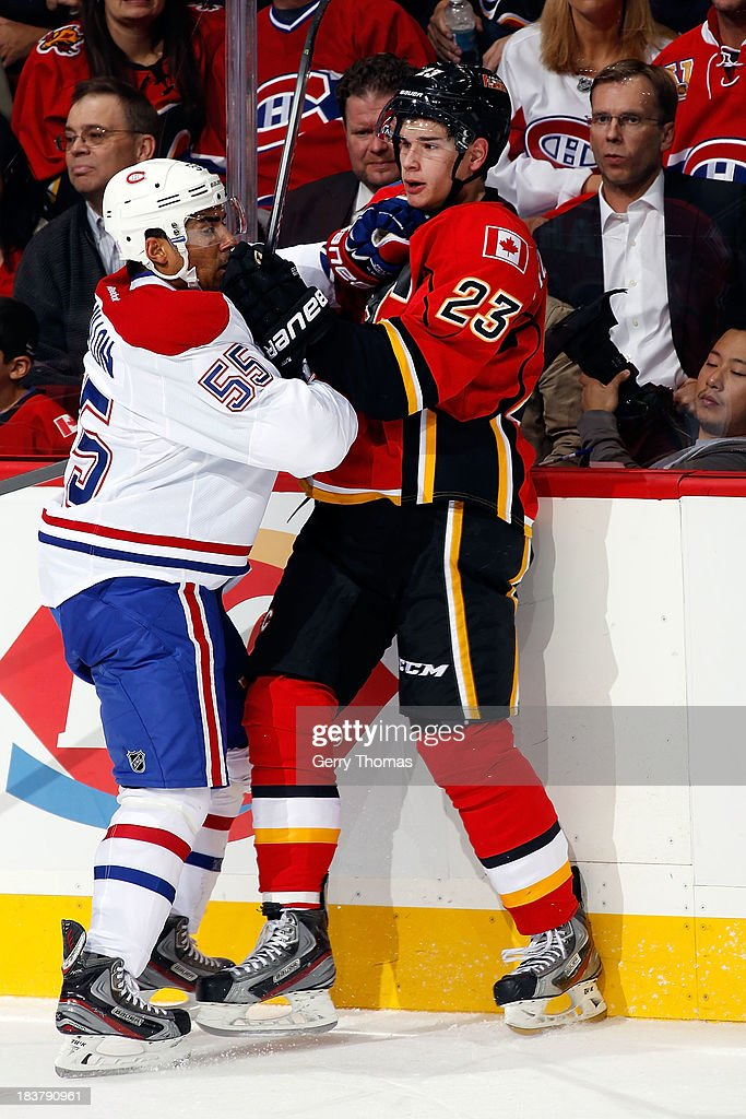 Sean Monahan #23 of the Calgary Flames skates against <a gi-track='captionPersonalityLinkClicked' href=/galleries/search?phrase=Francis+Bouillon&family=editorial&specificpeople=215165 ng-click='$event.stopPropagation()'>Francis Bouillon</a> #55 of the Montreal Canadiens at Scotiabank Saddledome on October 9, 2013 in Calgary, Alberta, Canada.