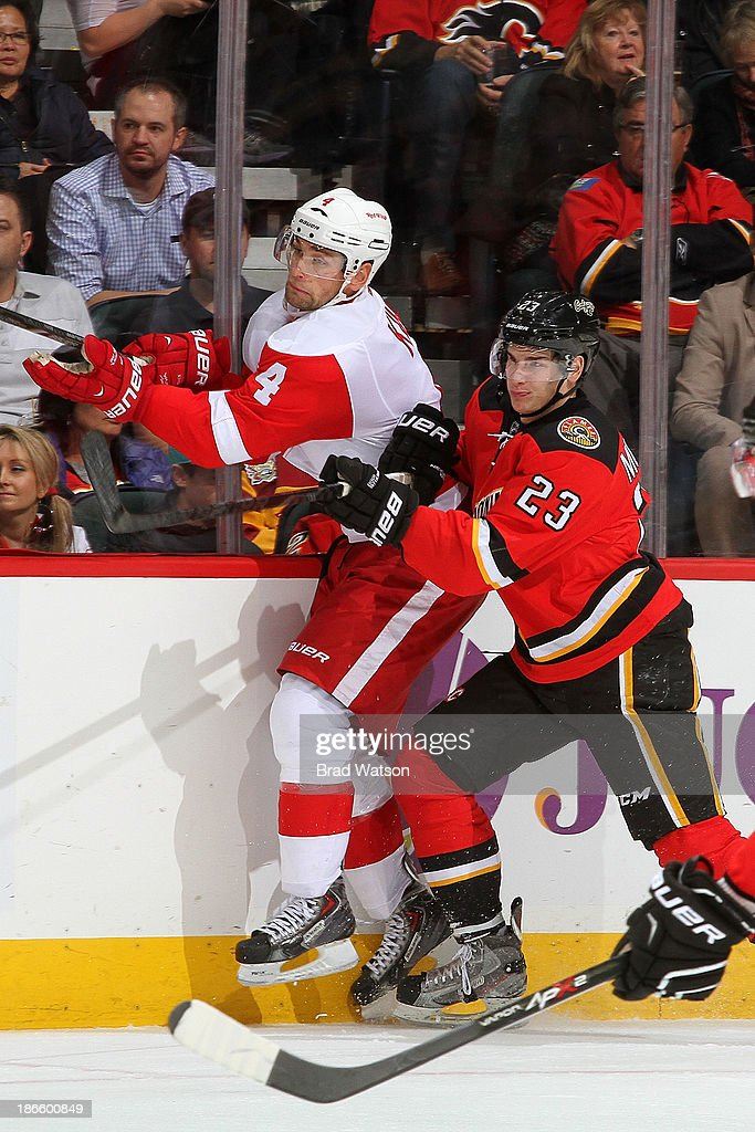 Sean Monahan #23 of the Calgary Flames skates against <a gi-track='captionPersonalityLinkClicked' href=/galleries/search?phrase=Jakub+Kindl&family=editorial&specificpeople=716743 ng-click='$event.stopPropagation()'>Jakub Kindl</a> #4 the Detroit Red Wings at Scotiabank Saddledome on November 1, 2013 in Calgary, Alberta, Canada.