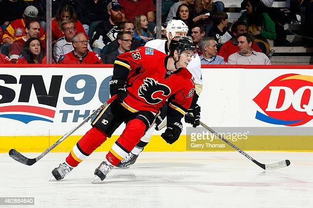 Sean Monahan of the Calgary Flames skates against the Pittsburgh Penguins at Scotiabank Saddledome on February 6 2015 in Calgary Alberta Canada