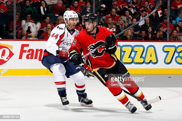 Sean Monahan of the Calgary Flames skates against the Washington Capitals at Scotiabank Saddledome on October 25 2014 in Calgary Alberta Canada The...