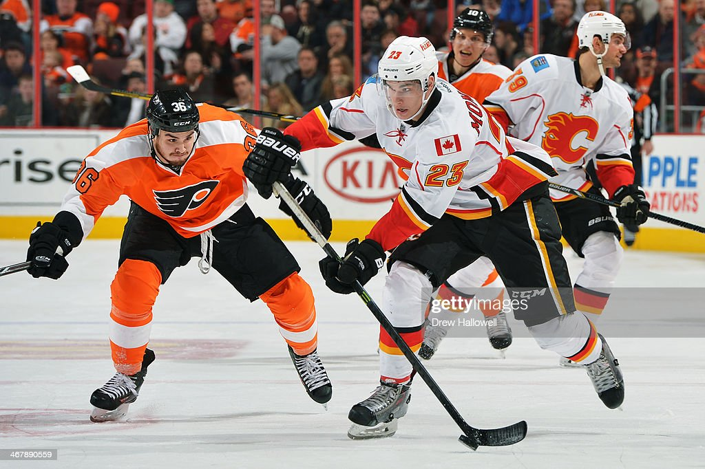 Sean Monahan #23 of the Calgary Flames skates as <a gi-track='captionPersonalityLinkClicked' href=/galleries/search?phrase=Zac+Rinaldo&family=editorial&specificpeople=4129574 ng-click='$event.stopPropagation()'>Zac Rinaldo</a> #36 of the Philadelphia Flyers tries to knock the puck away at the Wells Fargo Center on February 8, 2014 in Philadelphia, Pennsylvania. The Flyers won 2-1.