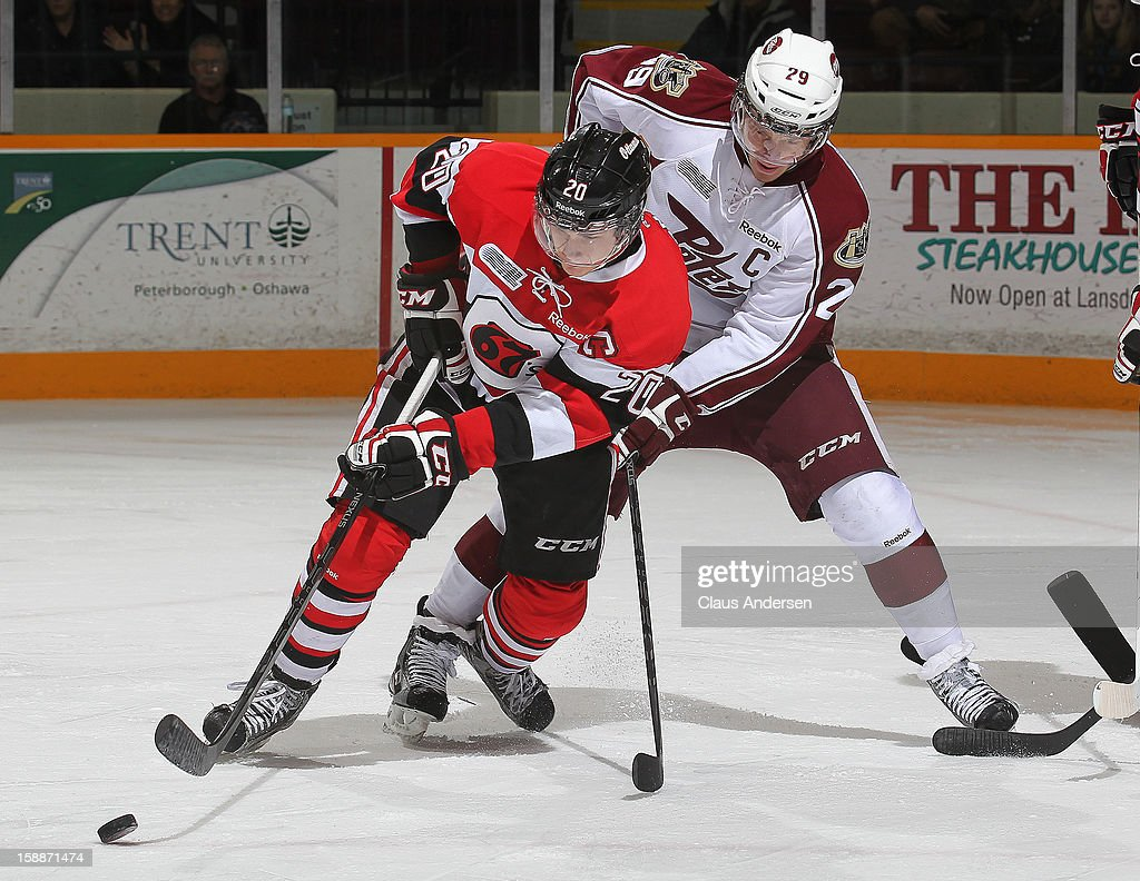Sean Monahan #20 of the Ottawa 67's tries to control a puck in front of <a gi-track='captionPersonalityLinkClicked' href=/galleries/search?phrase=Slater+Koekkoek&family=editorial&specificpeople=7406937 ng-click='$event.stopPropagation()'>Slater Koekkoek</a> #29 of the Peterborough Petes in an OHL game on December 29, 2012 at the Peterborough Memorial Centre in Peterborough, Canada. The 67's defeated the Petes 6-3.